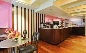 brightly colored cafe with tables, chairs, hardwood floors