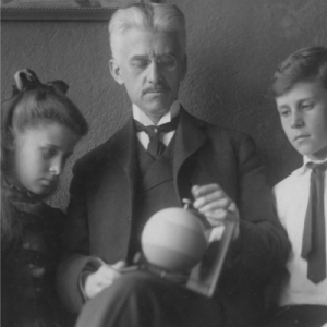 munsell holding color sphere with children