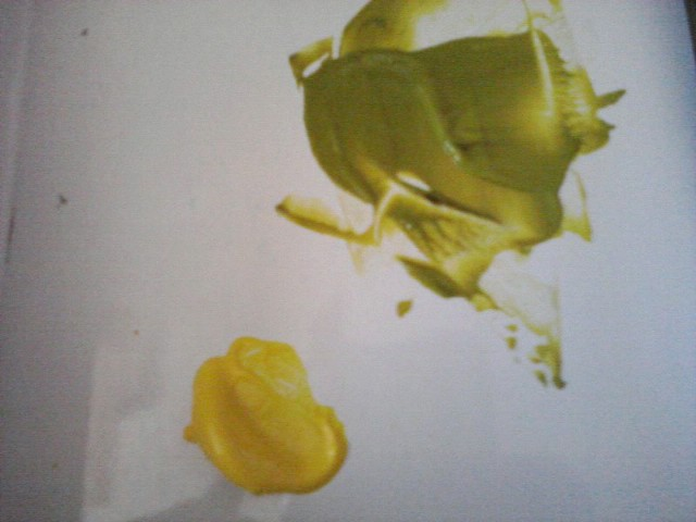 yellow paint mixed with black paint