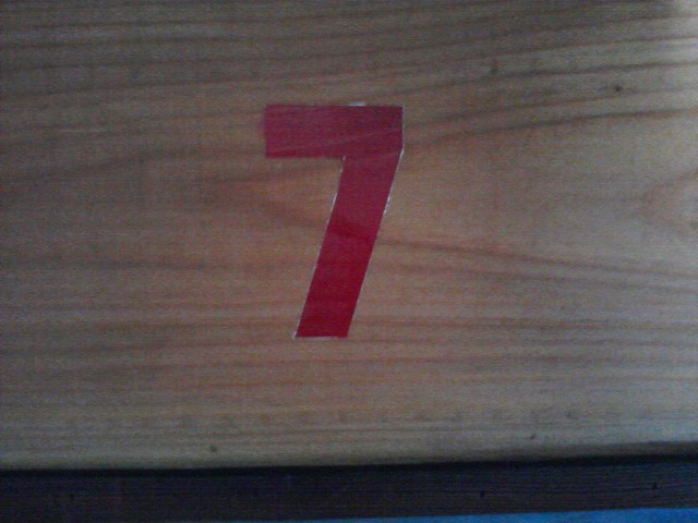 wood with number 7 painted on