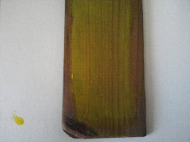 painting wood with yellow paint that became transparent