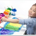 child painting with many colors