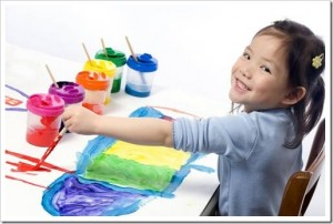 child painting with many colors - Colour Painting For Kids