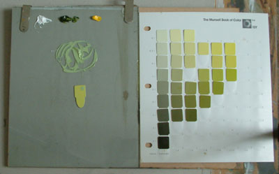 Paul Foxton referencing full Munsell Color Chart to mix oil paint colors
