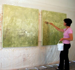 Artist Shirley Williams beginning painting on two canvases.