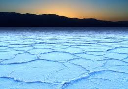 The light blue cracked surface of Badwater Basin in Death Valley, CA.