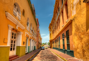 Orange-yellow colors of buildings on an old street in Cartagena, Columbia.