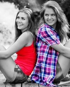 Example photo of two girls in black and white but with brightly colored shirts, done with the Color Splurge color app.