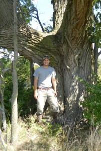 Photo of Brent Macolley, Environmental Scientist at MAD Scientist & Associates, standing next to a tree.