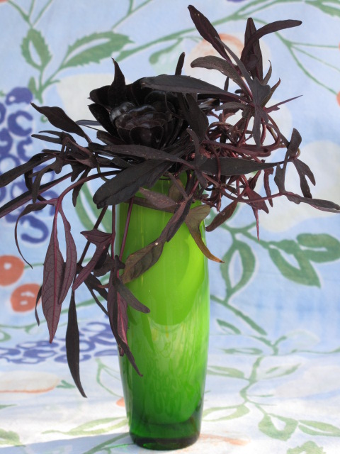 Burgundy Foliage in a Green Vase