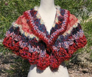 Designer hand knitted wearable art - the Mezza Luna Wrap, sold by Blackberry Bear on Etsy.