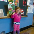 Child holding up her art design science project at the Rhinebeck Science Foundation Discovery Festival.