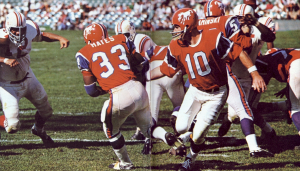 Denver Broncos in their old football uniforms from 1966.