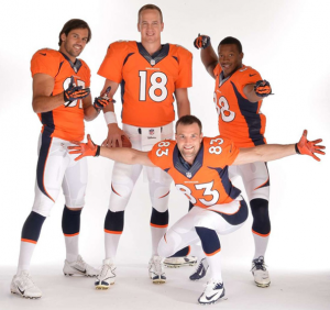 Denver Broncos football players in their 2012 uniforms.