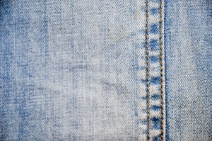 Close up of faded denim blue jeans.