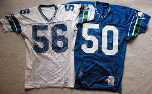 Two old football jerseys from the Seattle Seahawks.