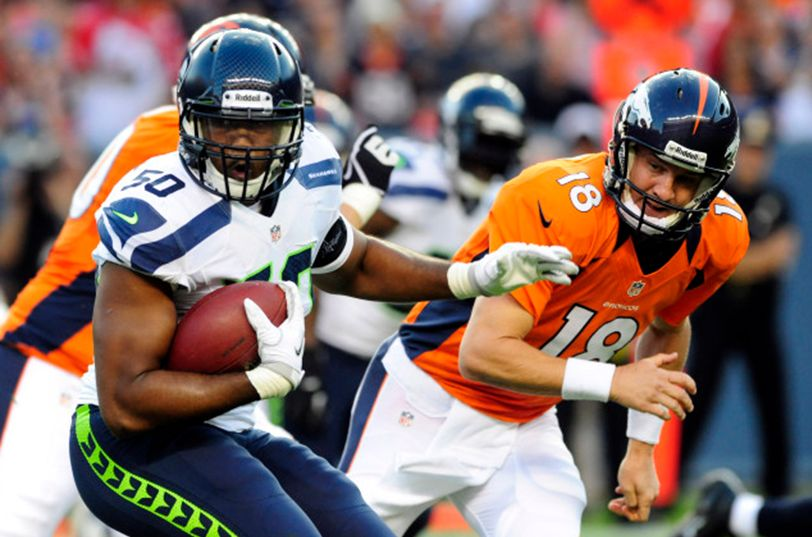 Football players from Seattle Seahawks and Denver Broncos during a game. Image courtesy of USA Today.