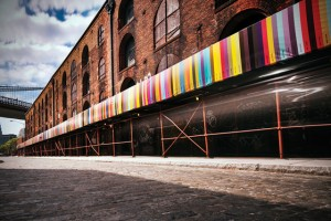 Chromapost building showing a wrapped around banner of various color swatches by Aleksandar Macasev