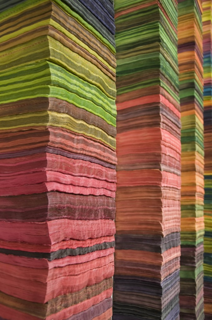 Close up view of the hand-dyed telephone books used in Katie Murken's art installation, Continua.