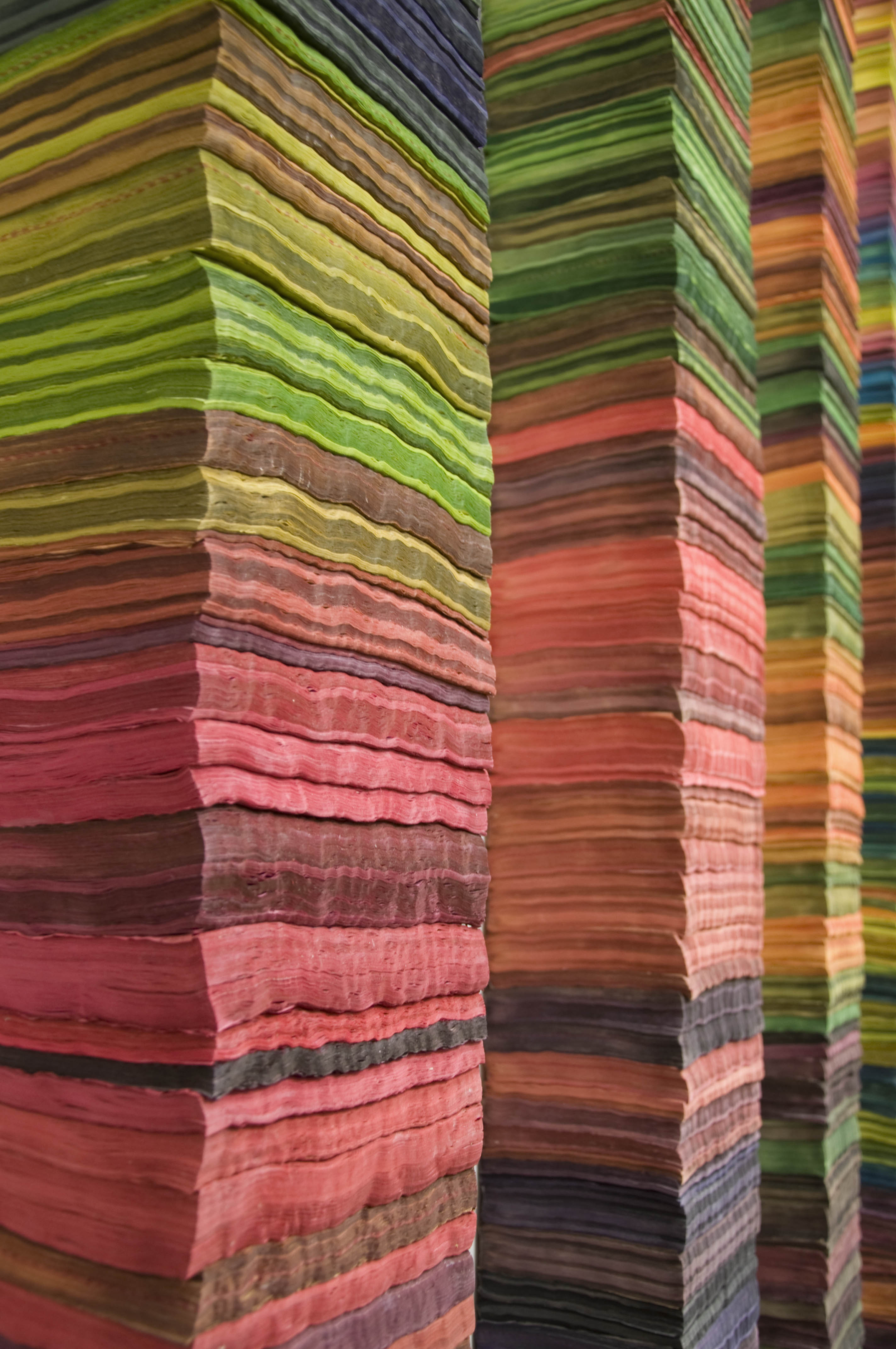 close up view of the hand dyed telephone books used in katie murkens art installation mapping color in space - Books On Color Theory