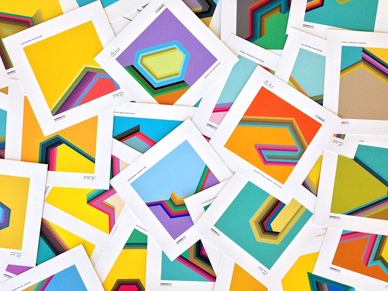 A pile of color swatches with various geometric patterns on white cards