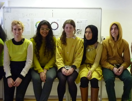 Spatial Design students wearing shades of yellow organize themselves based on hue, value and chroma.