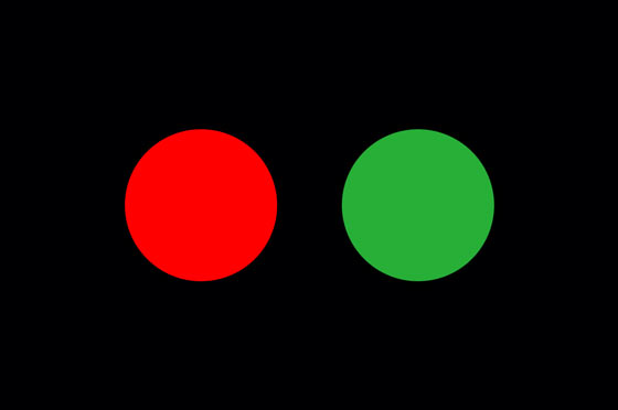 Red and green color signals on a black background
