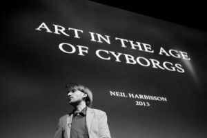 "Neil Harbisson giving presentation, ""Art in the Age of Cyborgs"" in 2013."