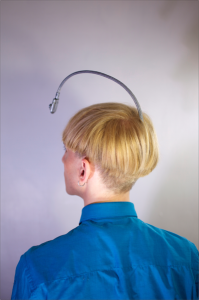 View of the antenna embedded in the back of Neil Harbisson's skull, a cyborg who perceives color via sound.