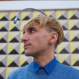 Side view of Neil Harbisson, who hears sound through a camera attached to an antenna on his head.