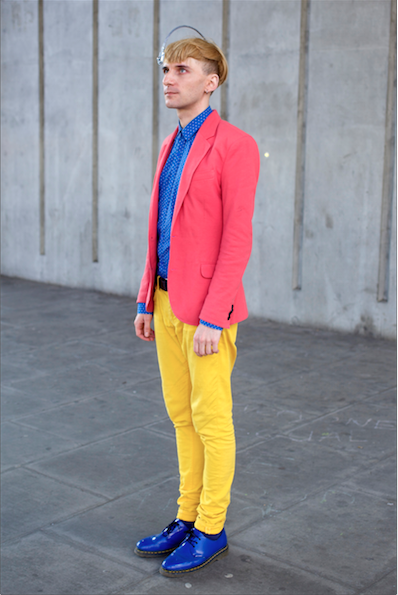 "Neil Harbisson, cyborg, dressed in bright colors that ""sound good""."