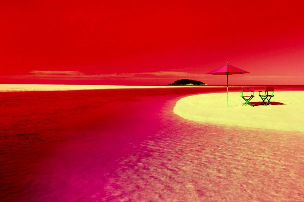 A beach scene with blue colors turned to red colors, based on Neil Harbisson, a color blind cyborg who hears colors, who says red sounds more relaxing than blue.