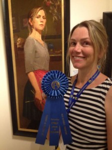 "Aimee Erickson with her work, ""Self Portrait with Key"" awarded the Award of Excellence for Portraiture at the Oil Painters of America National Exhibition in 2014."
