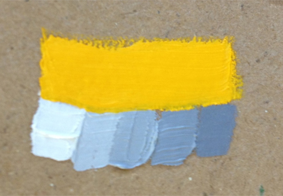 Yellow paint with various blue paint patches underneath - part of Aimee Erickson's test to see which blue value best matches the value of this yellow.
