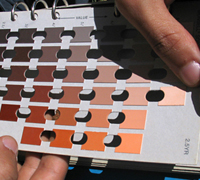A student uses a Munsell Color Chart in the field to determine how soil is formed
