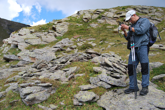 Geoarchaeologist Dr. Diego E. Angelucci  surveying the Alps to look for ancient shepherds' huts and enclosures