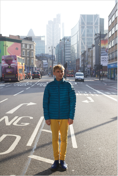 Neil Harbisson standing in the middle of a city street.