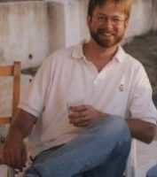 Andrew Reinhard, punk archaeologist, with a glass of wine.