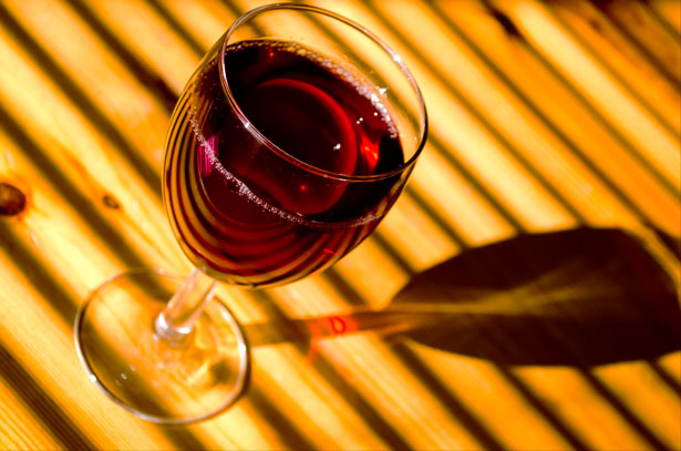 Glass of red wine in the sunlight.