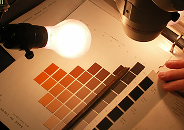 The Munsell color chart and microscope used in analyzing paint colors on the Lincoln funeral train car