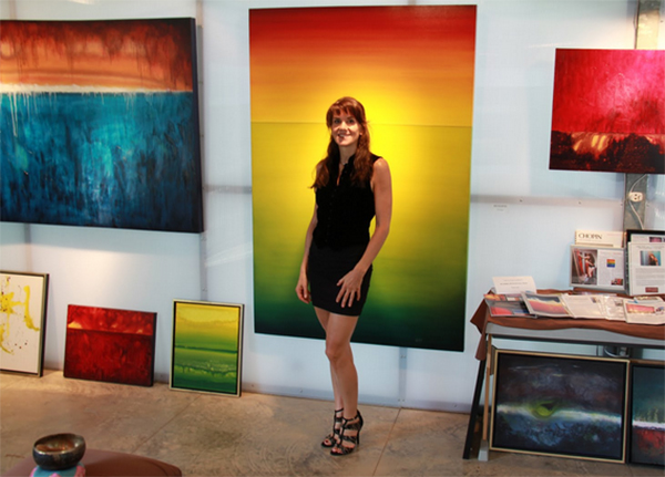 Leanne Venier in her Austin gallery with some of her paintings