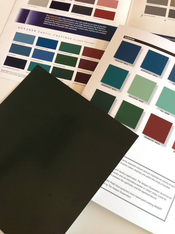 Several swatch books of paint chips along with Munsell color matching sheet