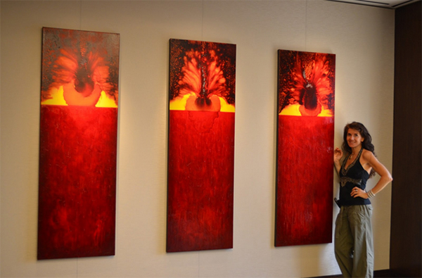 Leanne Venier stands in front of her painting The Chrysalis