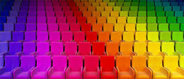 Inside and auditorium full of chairs in rainbow colors
