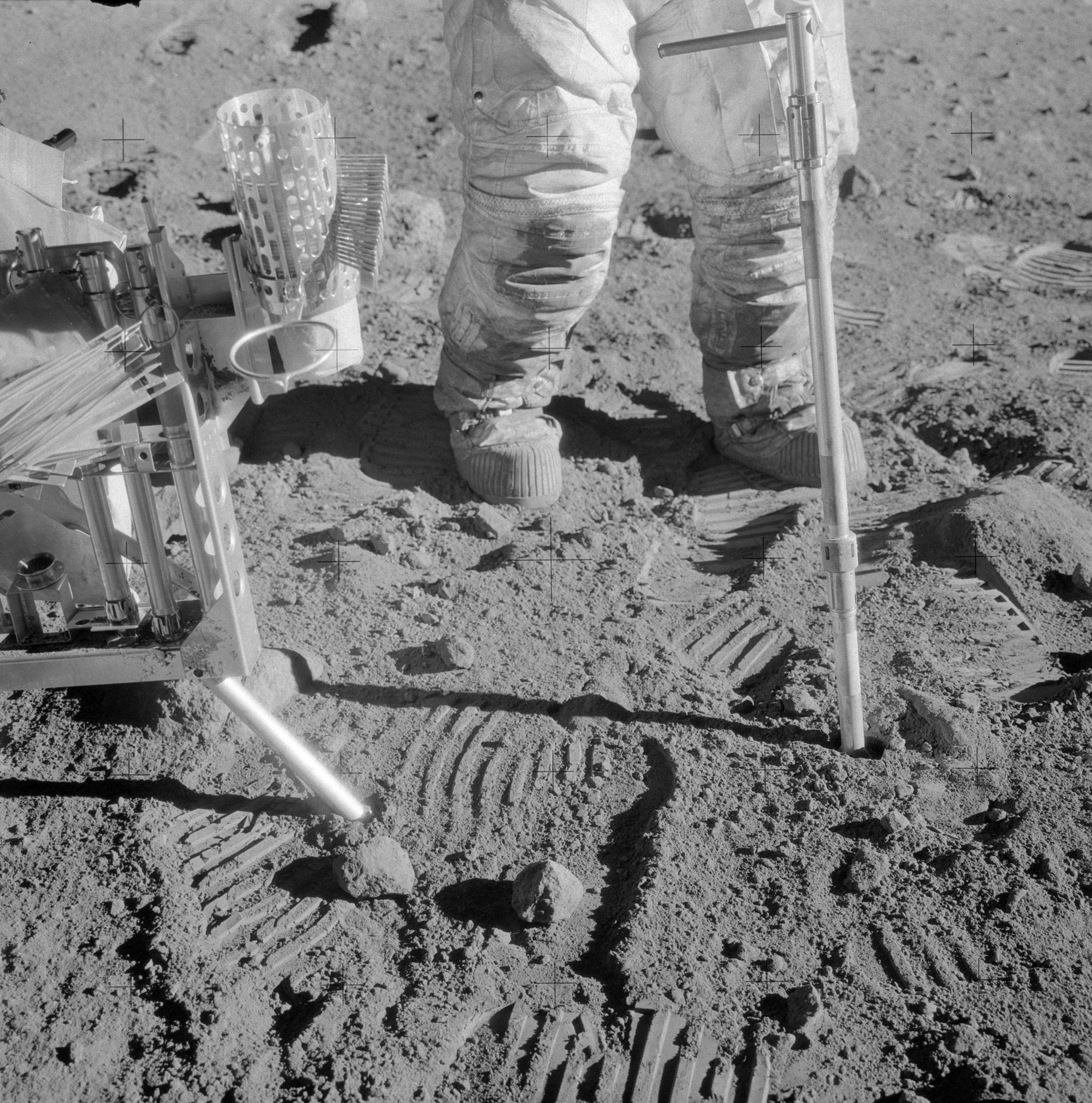 A 2-cm core tube being driven into the lunar soil at Bench Crater site by Apollo 12 astronaut Allan Bean.
