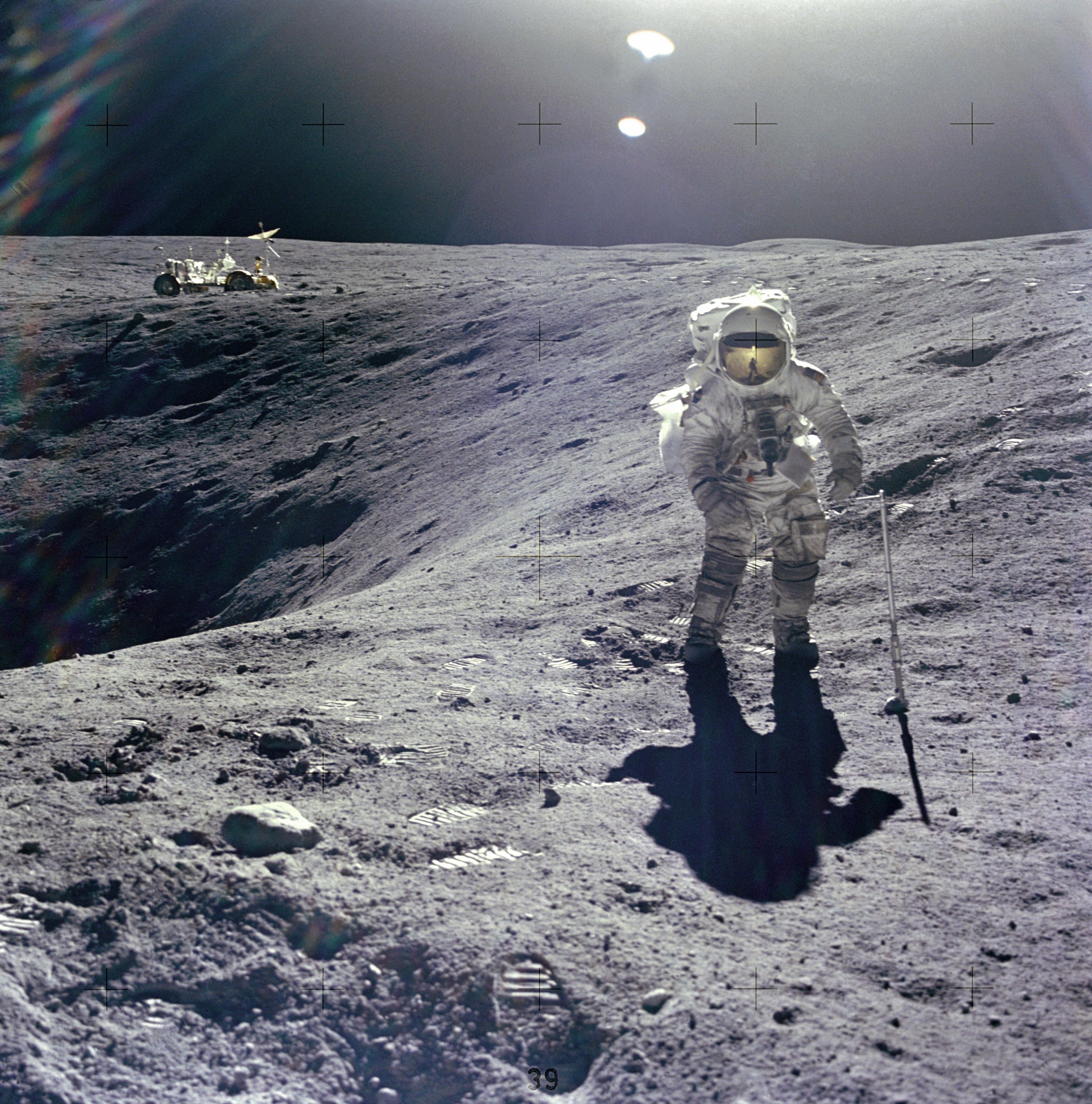 Astronaut Charles M. Duke Jr., Lunar Module pilot of the Apollo 16 mission, collecting lunar samples.