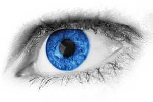 Close-up of a human eye with a deep blue iris.