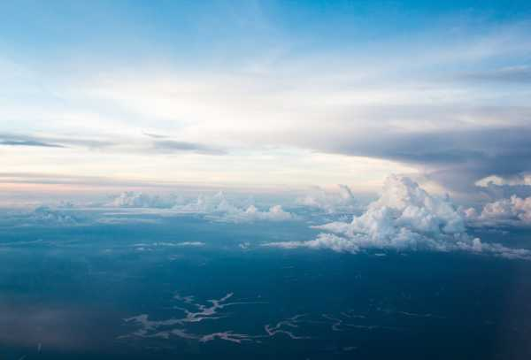 Blue hues in an aerial photo of sky and open space.