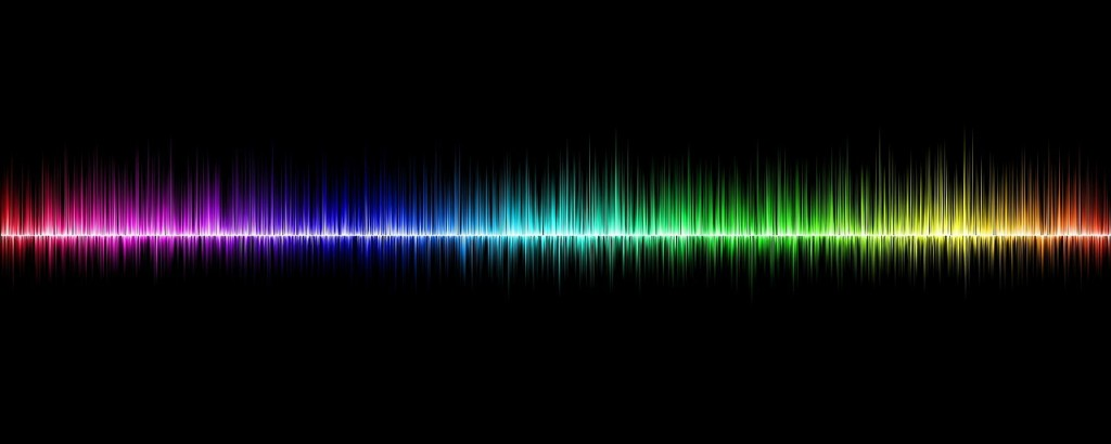 A rainbow coloured sound wave.
