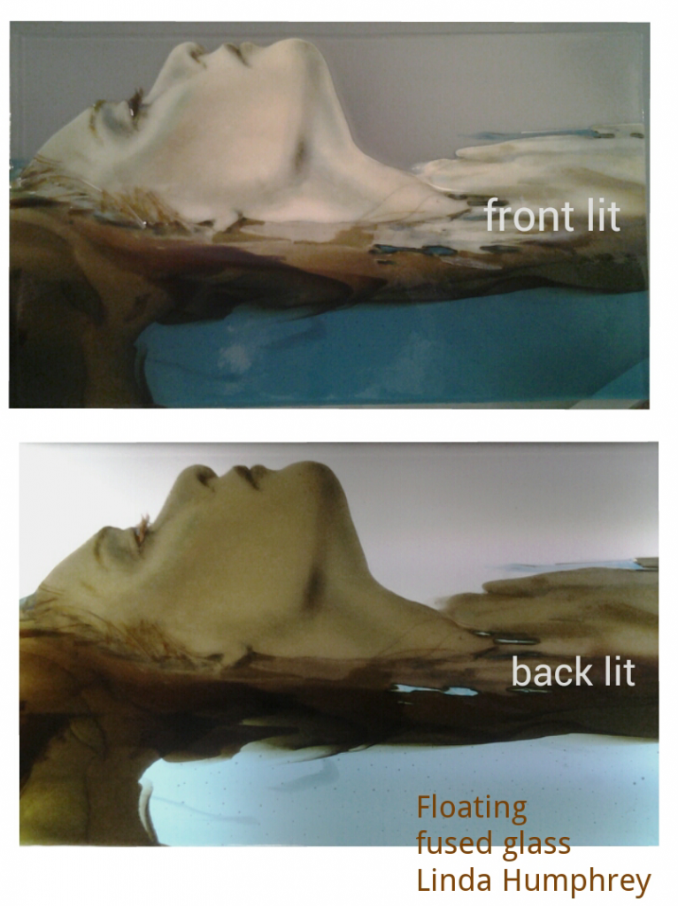 Floating, fused glass drawing by Linda Humphrey, showing the difference between front lit and back lit.